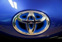 Toyota nine-month net profit dives 30%, cuts forecast