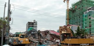 Three dead, dozens feared buried in Cambodia building collapse