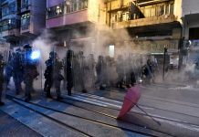 Tear gas fired at Hong Kong protesters close to Beijing's office