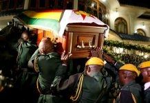 Zimbabwe's president says Mugabe died of cancer