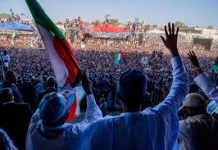 Nigeria's Buhari smuggled out of stadium to calm irate youths