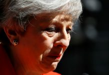UK's May quits as party leader, starting succession race