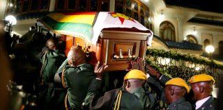 Zimbabwe's president says Mugabe died of cancer