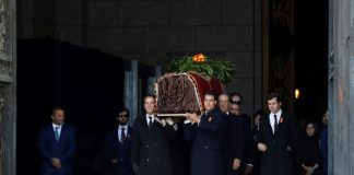 After exhumation, Spain reburies Franco in discreet tomb